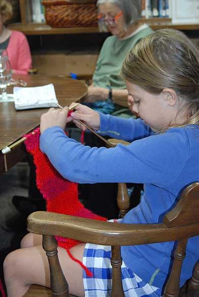 Young girl knitting