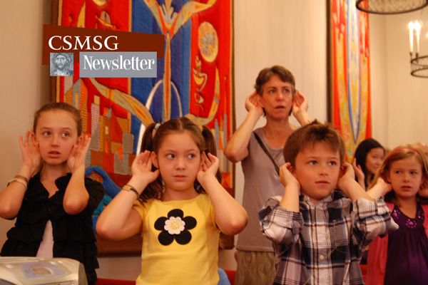 Children in St. George's Chapel signing to music.