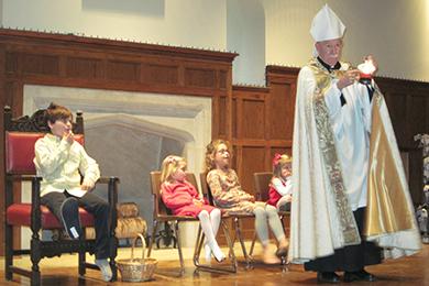 Saint Nicholas tells his story to the Church School children