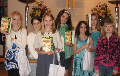 Church Schooler receiving new Bibles this past Sunday.