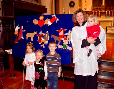 Laurie with children during Family Epiphany Night.