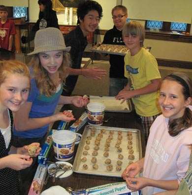 Youth Ministry making cookies for our college students.