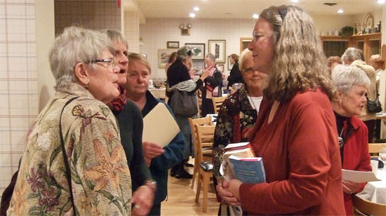 Washington Island Women's Club members talking with author Kathleen Ernst on October 16, 2012.