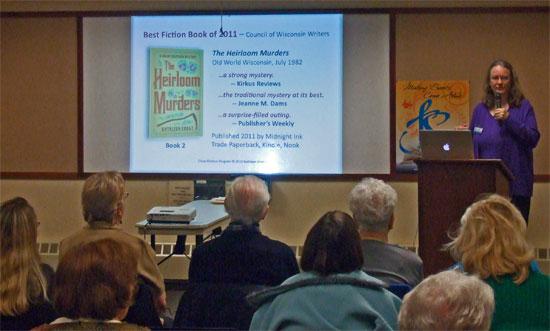 Photo of bestselling author Kathleen Ernst doing her Chloe Ellefson mysteries program at 2013 Fox Cities Book Festival.