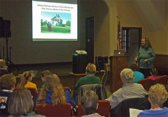 Kathleen Ernst doing her Chloe Ellefson mysteries program at Lake Mills Public Library 18 April 2013.