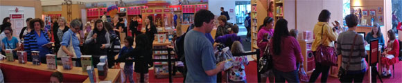 Photo of crowd in line to meet Caroline Abbott author Kathleen Ernst at American Girl Place store in Chicago, July 2, 2013.