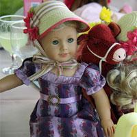 An American Girl Caroline Abbott doll and Garnet the calf plush toy.