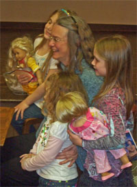 Kathleen Ernst posing with American Girl fans at Lake Mills Public Library 18 April 2013.