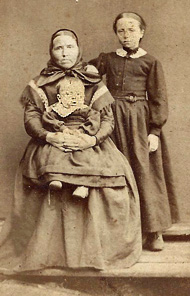 Sepia photo of mother and two children.