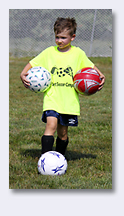 boy carrying balls