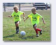 two kids yellow shirts