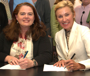 Kim and Laura signing