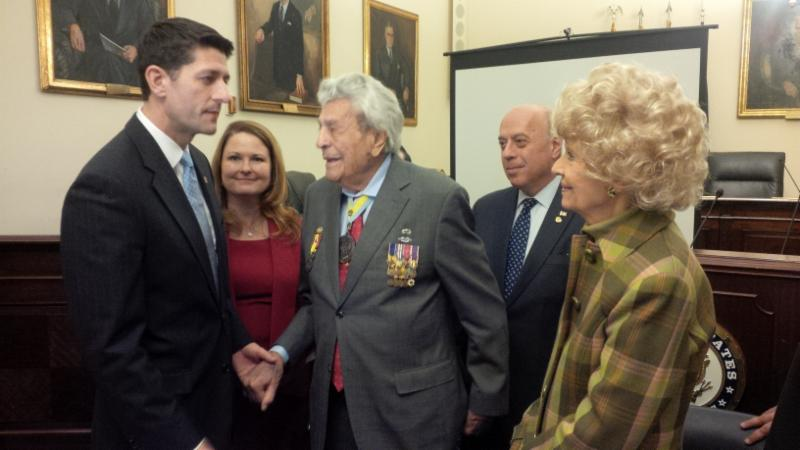 Speaker Paul Ryan greets Lt. Col. James Megellas and his wife_ Carole as Meredith Walker and Supreme Vice President Andrew Zachariades look on.