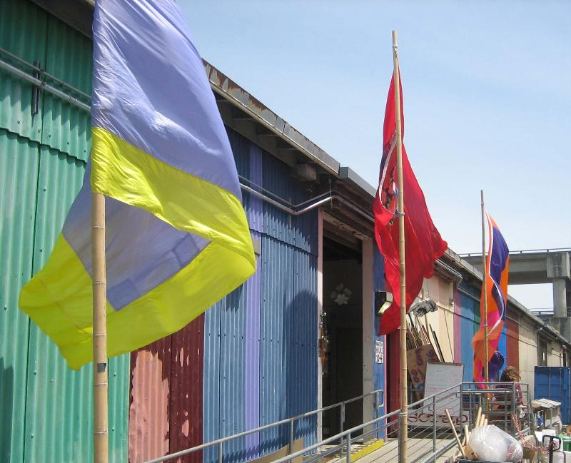 Richard Mora Flags Outside SCRAP