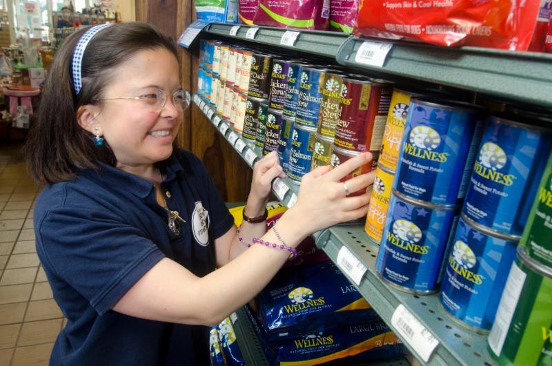 Kimiko stocks shelves at her job at a local pet store.