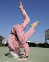 Pink gma headstand