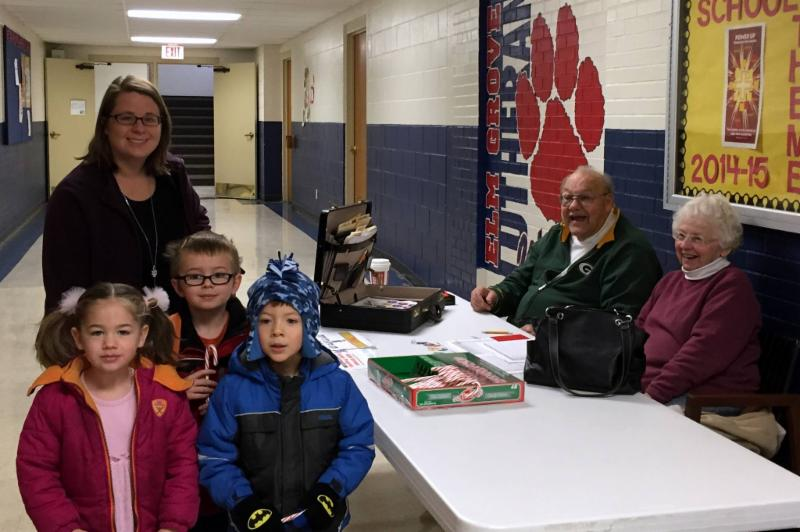 Tom and Patty Alles as they serve the children at Elm Grove Lutheran School as the familes purchase LCEF Stamps.
