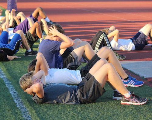Oakland students doing sit-ups.