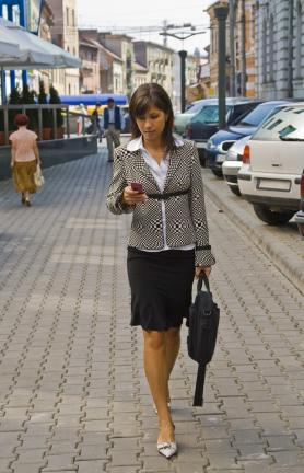 woman walking with cell phone