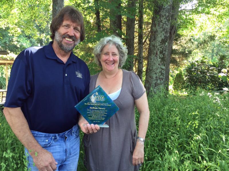 John and Jill Hoffman with Blue-Green Award at Hoffman Nursery