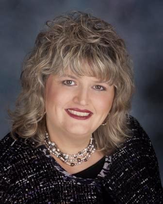 Linda M. Oliva as President