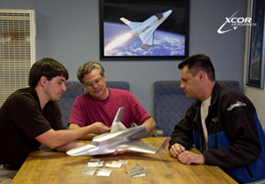 XCOR engineers discuss the wind tunnel model.