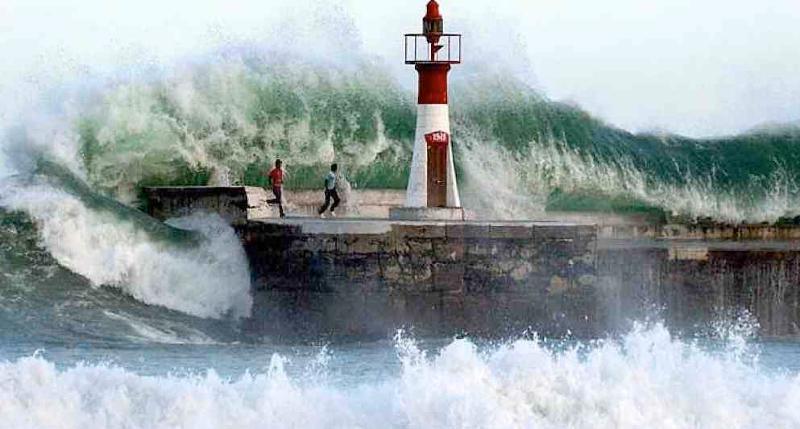 Wave engulfs men