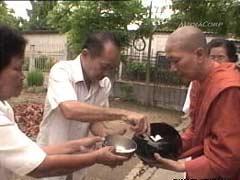 Monk receiving dana