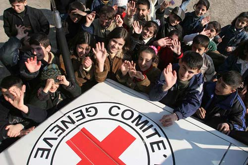 Young people with an ICRC vehicle