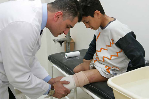 Singer Prosthetic and Orthopaedic Centre in Saida, Lebanon. A young boy maimed by cluster sub-munitions.