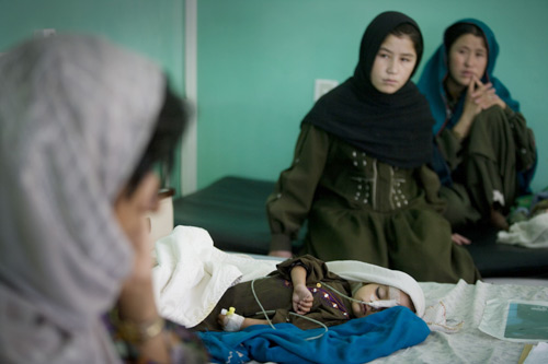 An Afghan child is treated for pneumonia at Mirwais Hospital.