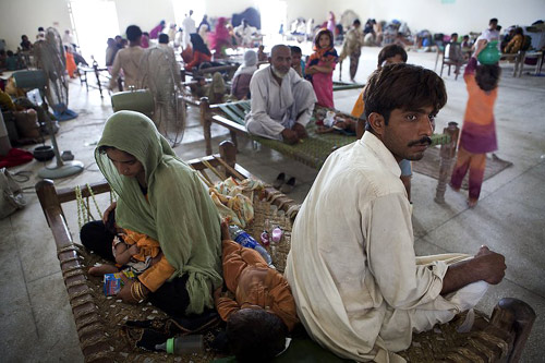 Muzzafargarh, Punjab Province. Families displaced by the floods seek food and shelter in a school.