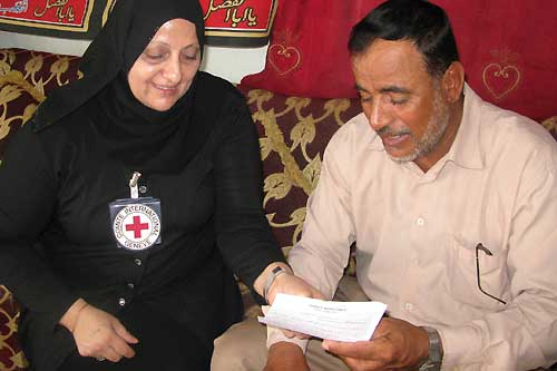The ICRC delivers an Red Cross message to the relative of a detainee, Basra, Iraq.