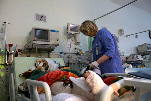 ICRC nurse checks on Libyan victims.