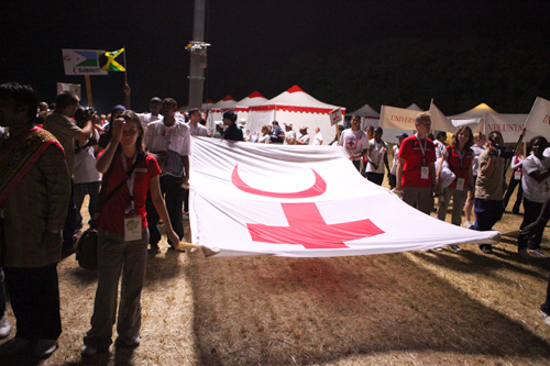 A large Red Cross and Red Crescent flag is unfurled in Solferino.