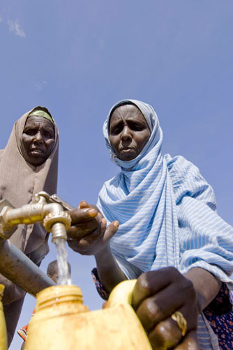 West of Dusamareb, Somalia. Women fetch water from a point set up by the ICRC