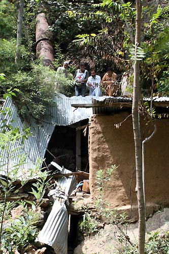 An ICRC water and sanitation team looks at the damage to a micro hydro-electric plant owned by a local man from Baykhanae village in Khyber Pakhtunkhwa.
