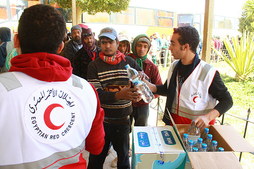 Volunteers giving out food at the Egyptian Border.