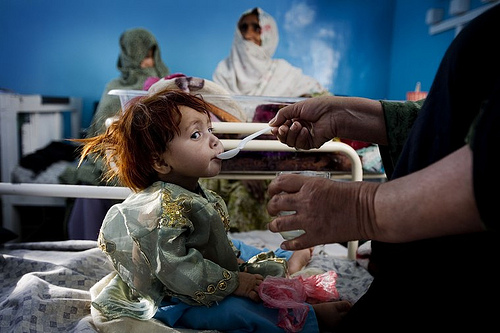 Afghanistan: A child being fed in the pediatrics ward of Mirwais Hospital.