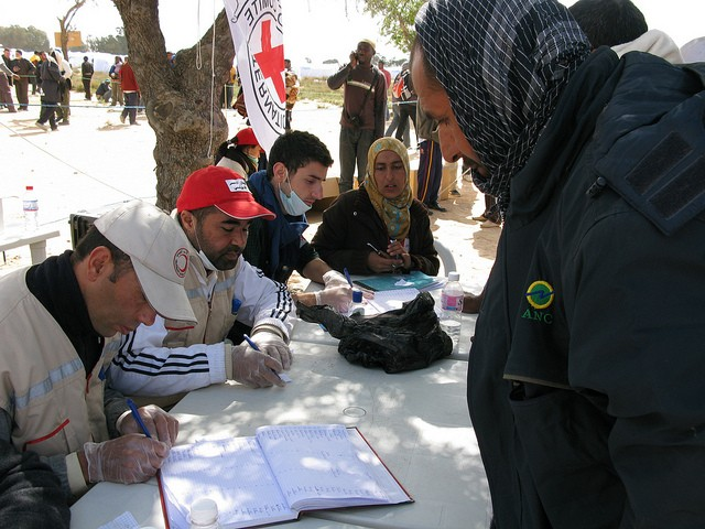 Tunisian Red Crescent volunteers register family details of people fleeing the internal armed conflict in Libya.