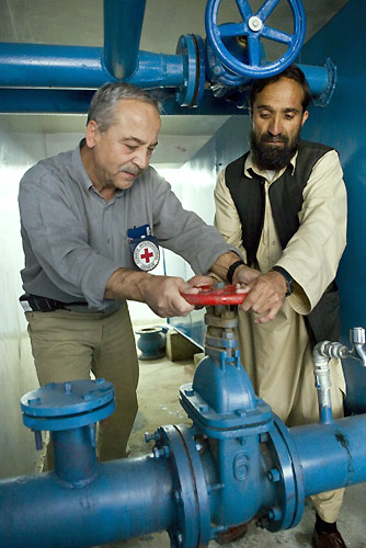 An ICRC Water and Sanitation Engineer Works at a Site