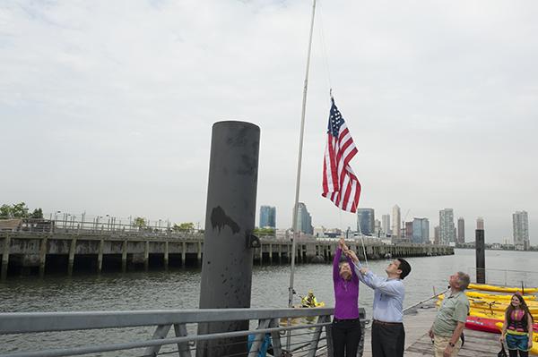 Raising the flag to formally inaugurate the 2015 kayaking season.