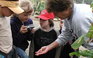 children in garden with docent