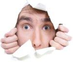 Man Peeking Through Paper