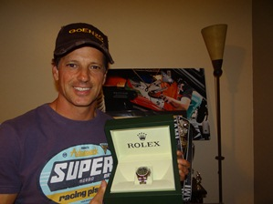 Ozz shows off his cap and winner's Rolex.