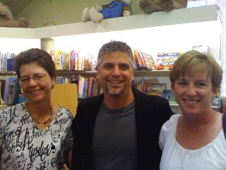 Garth visits with booksellers and readers during a book tour.