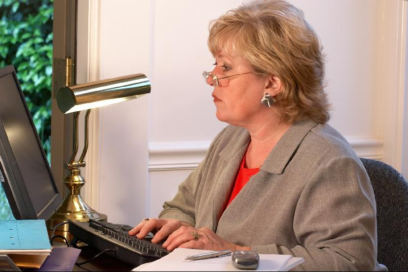 Mature woman typing