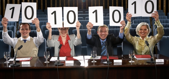 Judges Holding Up Score Cards