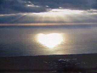 sunlight heart on ocean