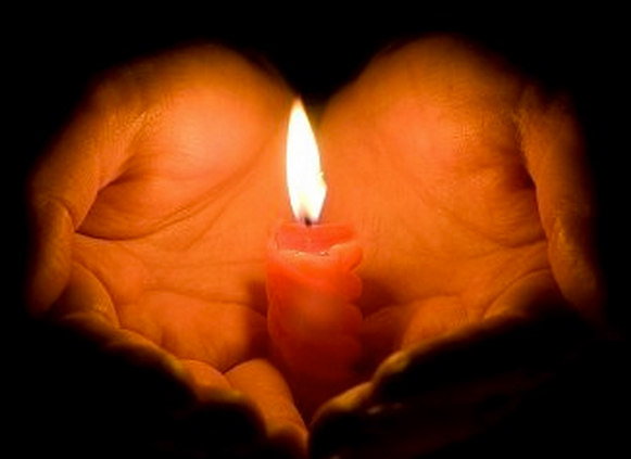 candle in heart hands
